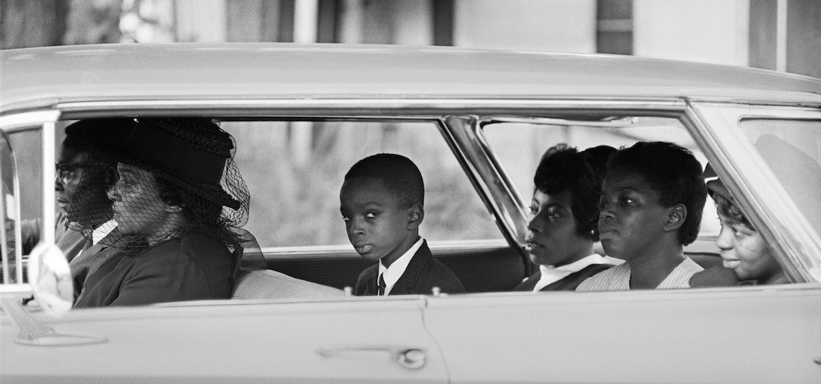 The Chaney family as they depart for the burial of James Chaney, Meridian, Mississippi, August 7, 1964.