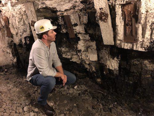 """Power Trip"" director Jonathan Scott inspects the wall of a former coal mine in Lynch, Kentucky."