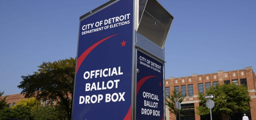 Voters can drop off absentee ballots at a ballot drop box in Detroit instead of using the mail.