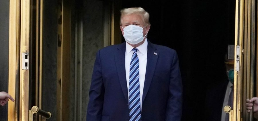 President Trump walks out of Walter Reed National Military Medical Center Monday.