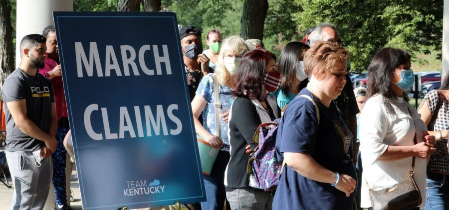 Hundreds of unemployed Kentucky residents wait in long lines outside the Kentucky Career Center in Frankfort for help with their unemployment claims on June 19. New research shows savings built up by the jobless are starting to run out.