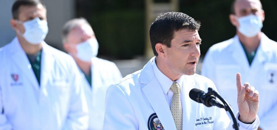 White House physician Sean Conley updates the press on the health status of President Trump on Sunday.