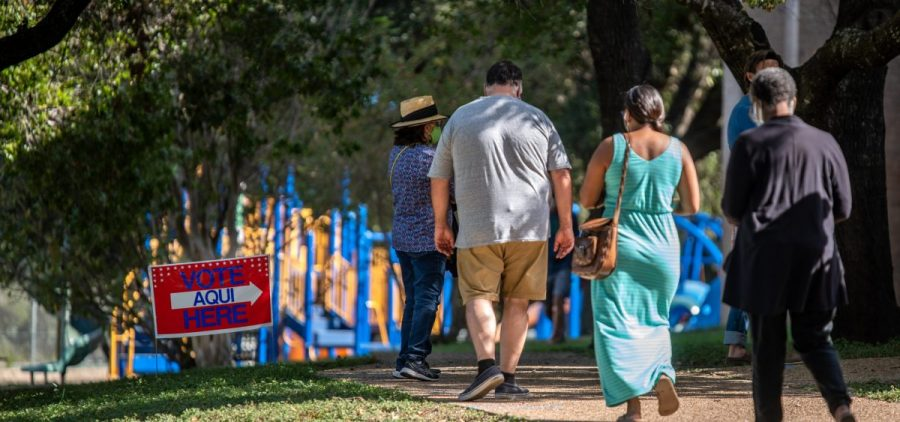 Voters approach a polling location in Austin, Texas, on Oct. 13 — the first day of voting in the state. Nearly 8 million votes already have been cast in Texas.
