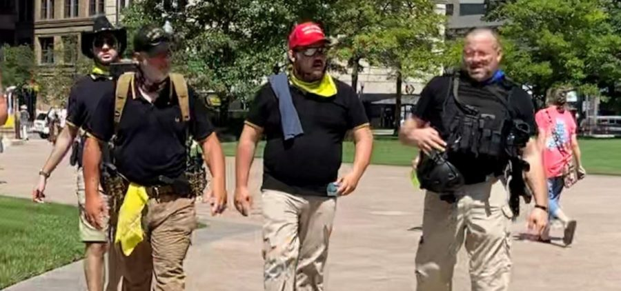"Some demonstrators at an anti-mask rally at the Statehouse in July. Event planners said security would be provided by ""militia"". Proud Boys are often identified by black collared polo shirts with yellow stripes on the sleeves."