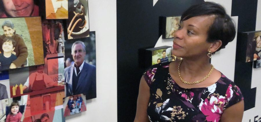 FILE - In this Aug. 15, 2019 file photo Kimberly Hall, director of the Ohio Department of Job and Family Services, looks over a photo display outside her office, in Columbus, Ohio.