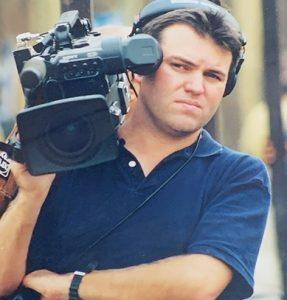 Brian Miller holding camera