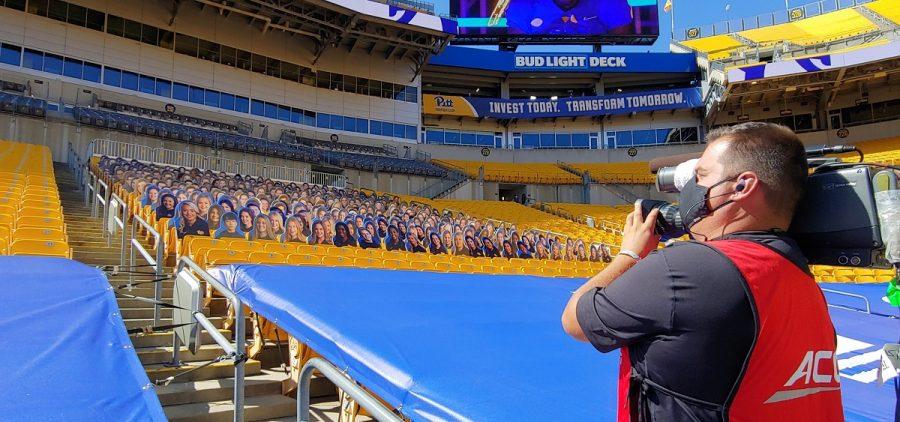 Mark Hug shooting a football game