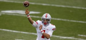 Ohio State quarterback Justin Fields throws a pass during an NCAA college football game against Michigan State, Saturday, Dec. 5, 2020, in East Lansing, Mich. Ohio State won 52-12.