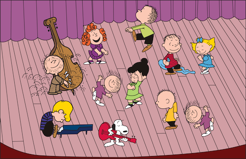 Charlie Brown charactewrs dancing on stage