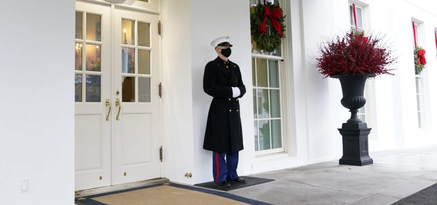 A Marine stands outside the West Wing of the White House last week. President Trump has been lobbied by advocates to use his powers to grant pardons and commutations ahead of leaving office.