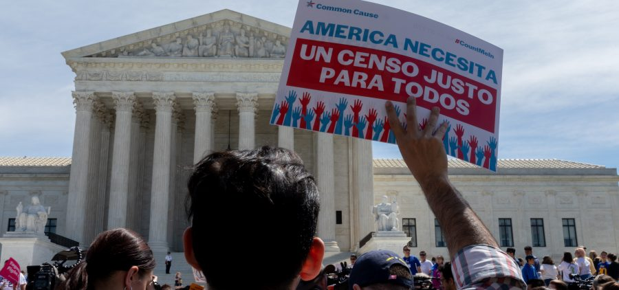 Protesters carrying signs about the census gather outside the U.S. Supreme Court in 2019.