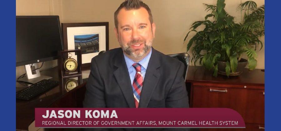 Jason Koma at desk