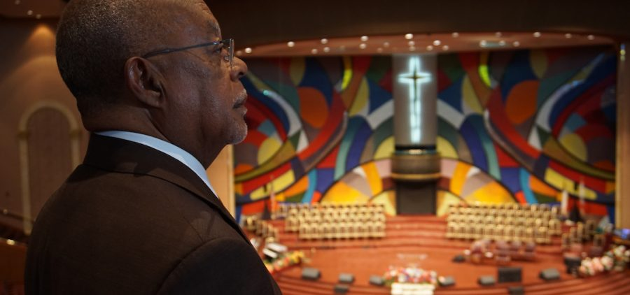 Host, Henry Louis Gates Jr., admires the mural at Church of God In Christ West Angeles.