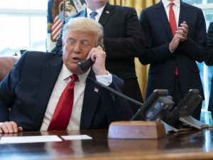 President Trump's phone call on Saturday with Georgia Secretary of State Brad Raffensperger spurred debates over whether the call broke the law. Here, Trump talks to the leaders of Israel and Sudan in October.