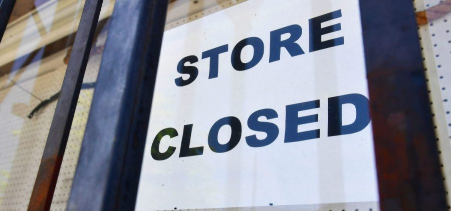 """A """"store closed"""" sign is posted at a store in Los Angeles on July 16, 2020. The U.S. economy slowed sharply in the last three months of the year from the previous quarter as the pandemic made a resurgence."""