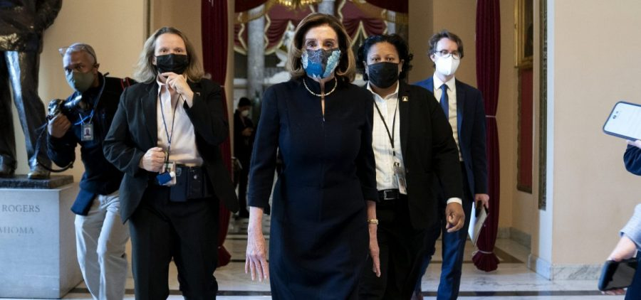 "House Speaker Nancy Pelosi, D-Calif., said that impeaching President Trump is ""a constitutional remedy that will ensure that the republic will be safe from this man."" She's seen here walking to the House floor on Wednesday, ahead of the vote."