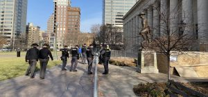 A group of Ohio State Highway Patrol troopers helps with putting up fencing around the closed-off entrance to the west side of the Ohio Statehouse, where protests are often held.
