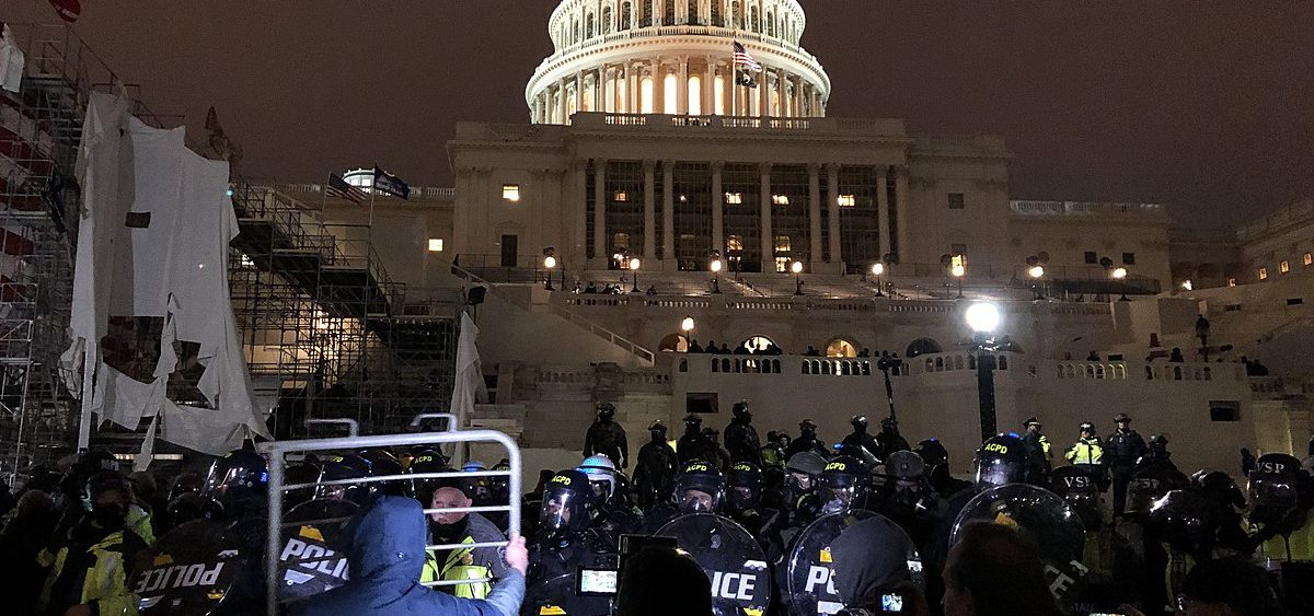 CAP Police and protesters outside the United States Capitol.