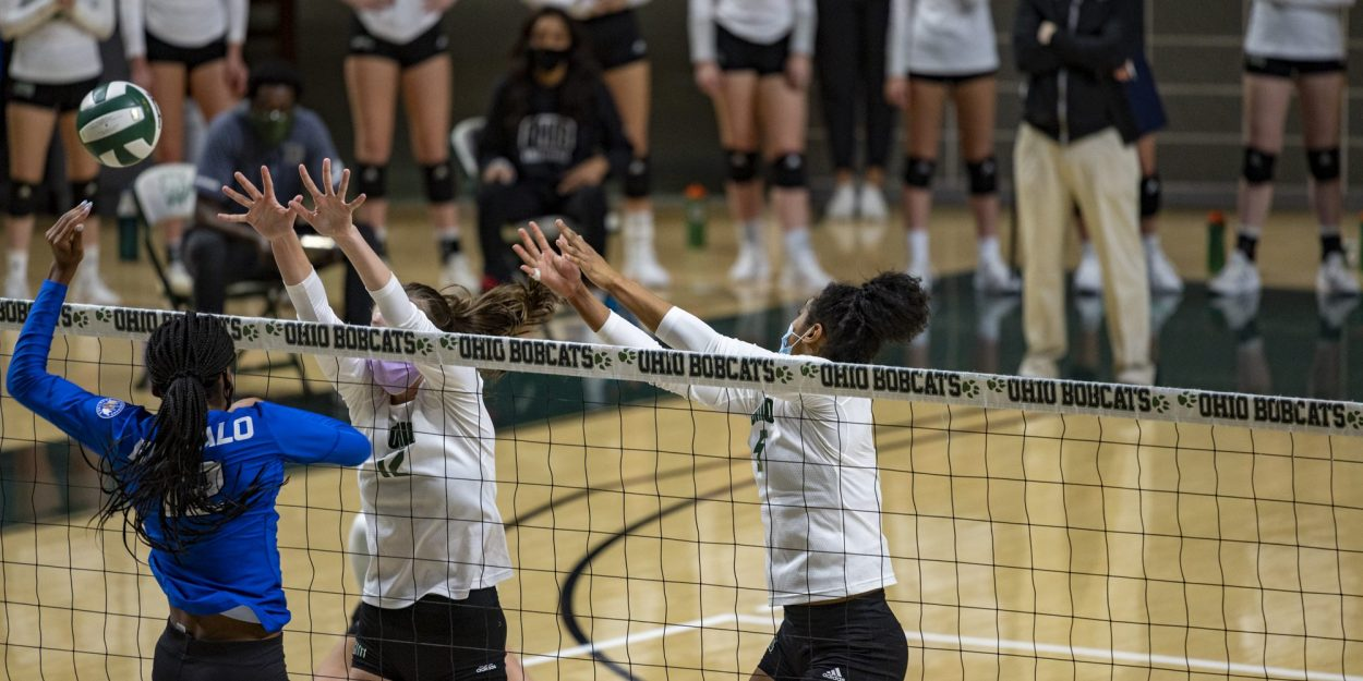 Ohio Volleyball vs Buffalo: Caitlin O'Farrell (12) and Mariana Rodrigues (5) jump to block a hit from Courtney Okwara (12). (Photo: Evann Figueroa/WOUB)