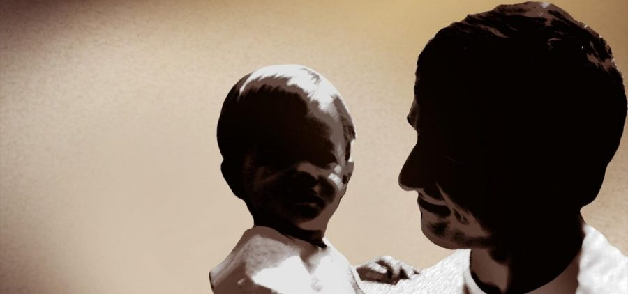 A graphic of a father holding a child