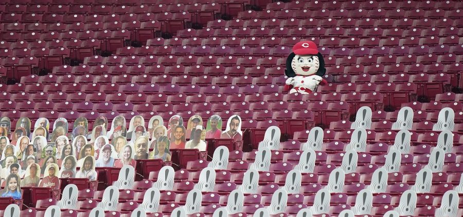A Cincinnati Reds mascots sits in empty stands during a baseball game against the St. Louis Cardinals at the Great American Ballpark, in Cincinnati, Tuesday, Sept. 1, 2020