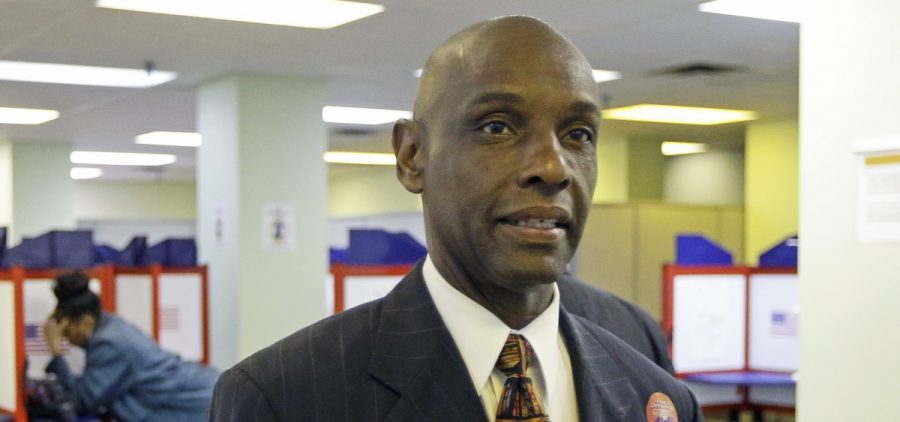 This Tuesday, Oct. 7, 2014 file photo shows Ohio senate candidate Cecil Thomas arriving at the Hamilton County Board of Elections, on the first day of early voting in Cincinnati.