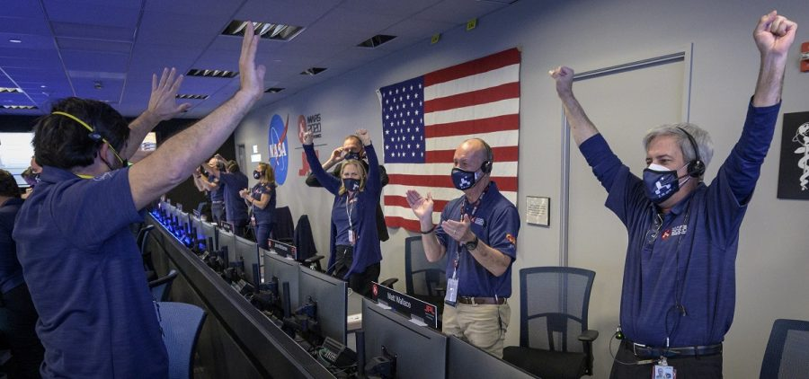 Members of NASA's Perseverance rover team react in mission control after receiving confirmation the spacecraft successfully touched down on Mars, Thursday, Feb. 18, 2021, at NASA's Jet Propulsion Laboratory in Pasadena, Calif. The landing of the six-wheeled vehicle marks the third visit to Mars in just over a week. Two spacecraft from the United Arab Emirates and China swung into orbit around the planet on successive days last week.