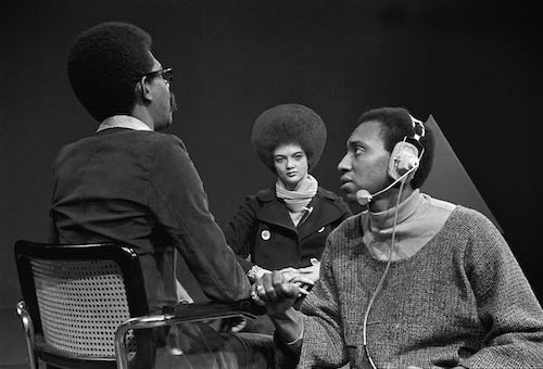 Producer (left) speaks with stage manager (right) before an interview