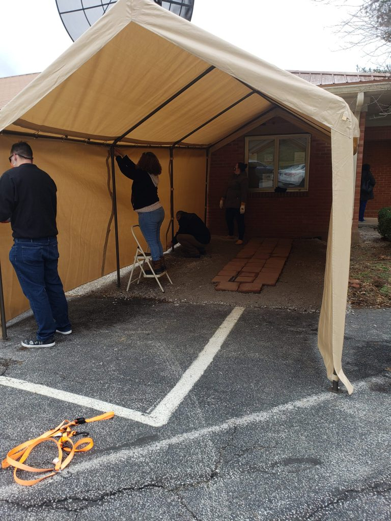 Health workers in Franklin County, KY, use a tent to keep a syringe exchange going in winter.