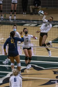 Tia Jimerson (15) goes to score during the first set of OHIO's match against Toledo at the Convocation Center in Athens, Ohio, on Wednesday, March 17, 2021. (Photo: Evann Figueroa/WOUB)
