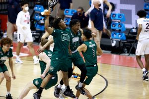 The Ohio Bobcats celebrate after their 62-58 win over the Virginia Cavaliers in the first round of the 2021 NCAA Division I Men's Basketball Tournament held at at Simon Skjodt Assembly Hall on March 20, 2021 in Bloomington, Indiana. (Photo by Grant Halverson/NCAA Photos via Getty Images)