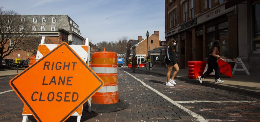 One lane of Court Street and the sidewalk remained closed Tuesday in front of a building that was evacuated Friday because of structural issues with one of the exterior walls.