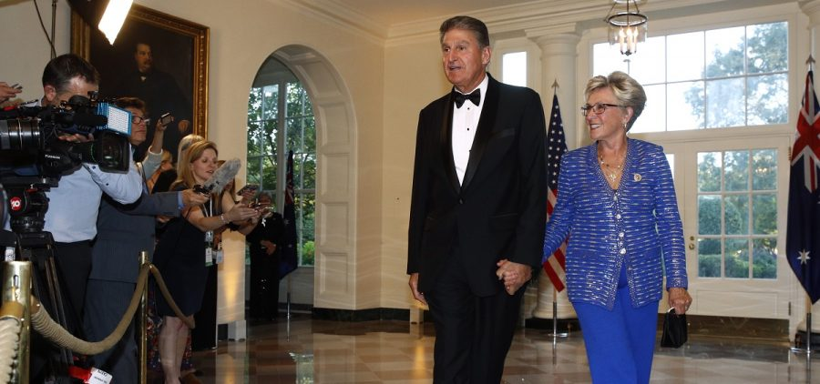 Sen. Joe Manchin, D-W.Va., left, and wife Gayle Conelly Manchin arrive for a State Dinner with Australian Prime Minister Scott Morrison and President Donald Trump at the White House, Friday, Sept. 20, 2019, in Washington.