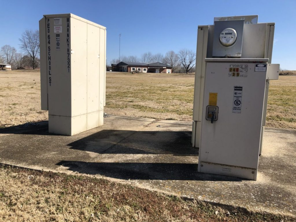 AT&T distribution boxes in Tolu, Kentucky. Hughes says fiber was installed here in 2006