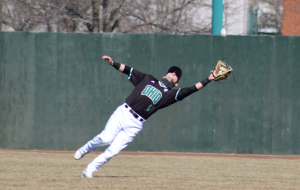Ohio's left fielder Cole Revels extends to make a catch in Ohio's game against Milwaukee on Sunday, March 7, 2021. Ohio only committed three errors in the four-game series. (Photo: Nick Viland/WOUB)