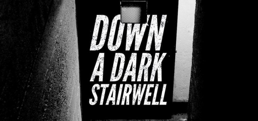 "the words ""Down a dark stairwell"" imposed on a dark stairwell"