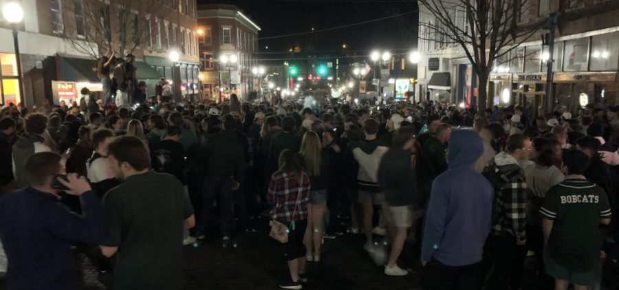 Students on Court Street after OU's win in the NCAA Men's Basketball Tournament Saturday, March 20