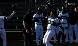 Spencer Harbert celebrates his home run with his team as the Ohio Bobcats baseball team competes against the University of Wisconsin-Milwaukee at Bob Wren Stadium on Friday, March 5, 2021, in Athens, OH. Ohio defeated Milwaukee 14-3. (Chris J. Day/WOUB)
