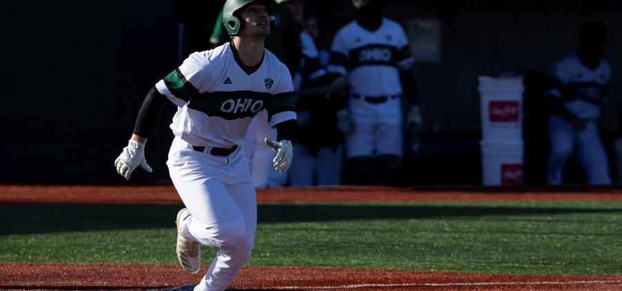 Spencer Harbert watches his home run sail over the fence as the Ohio Bobcats baseball team competes against the University of Wisconsin-Milwaukee at Bob Wren Stadium on Friday, March 5, 2021, in Athens, OH. Ohio defeated Milwaukee 14-3. (Chris J. Day/WOUB)