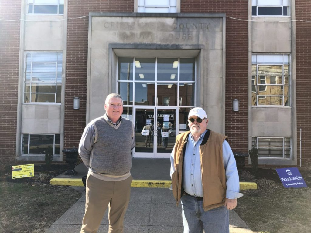 Crittenden County Judge-Executive Perry Newcom (left) and County Magistrate Dan Wood (right) stand in front of the county courthouse.