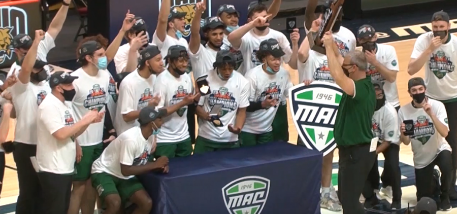 Ohio Men's Basketball is the MAC Tournament champions. The Bobcats huddle around the trophy postgame.