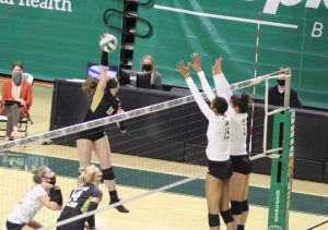 Ohio's Tia Jimerson (15) and Mariana Rodrigues (5) leap to block a spike against Western Michigan on Friday, March 19, 2021. (Photo: Curtis Feder/WOUB)