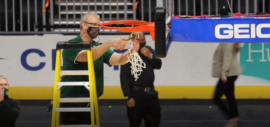 Ohio's Jeff Boals cuts down the net following the Bobcats' MAC Tournament championship on Saturday, March 13, 2021. (Photo: Bryan Kurp/WOUB)
