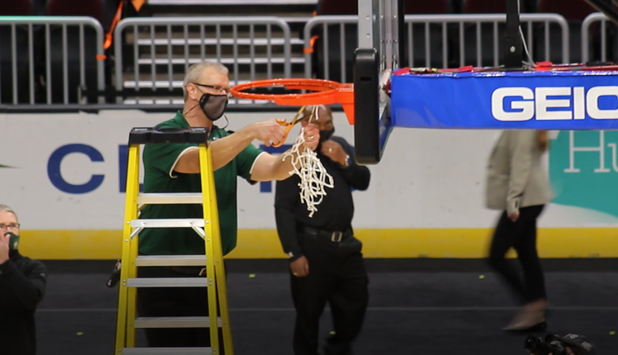 Ohio's Jeff Boals cuts down the net following the Bobcats' MAC Tournament championship on Saturday, March 13, 2021. (Photo: Bryan Kurp/WOUB)