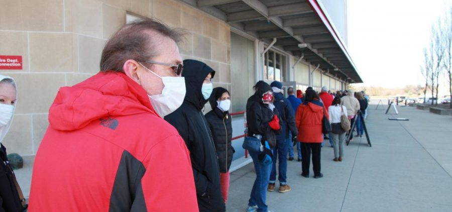 Columbus residents line up for their COVID-19 vaccination at St. John Arena on Ohio State's campus on March 19, 2021.