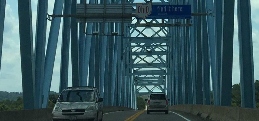 """The """"Ohio Find It Here"""" sign welcomes people on the William S. Ritchie Jr. Bridge, also known as the Ravenswood Bridge, on the border with West Virginia."""