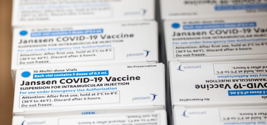 Boxes containing vials of the Janssen COVID-19 vaccine sit in a container before being transported to a refrigeration unit at Louisville Metro Health and Wellness headquarters on March 4 in Louisville, Ky. The FDA approved the third COVID-19 vaccine on Feb. 27.