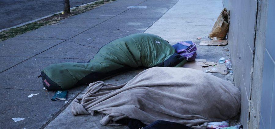Homeless individuals sleep near a National Guard truck ahead of the inauguration of U.S. President-elect Joe Biden on Jan. 20, 2021, in Washington, D.C.