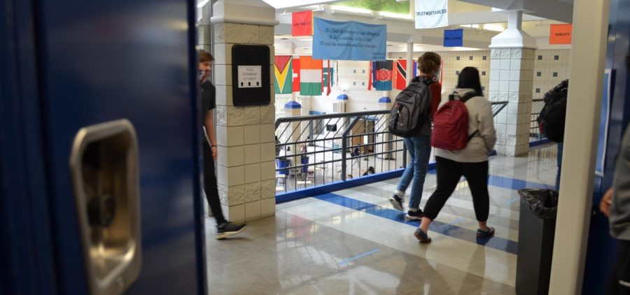 Kids walk to class in the hallway of Worthington Kilbourne High School. All students will be back in the district's schools for in-person learning starting March 22.