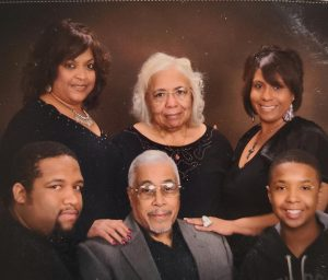 Mary Ann Rollins with her family
